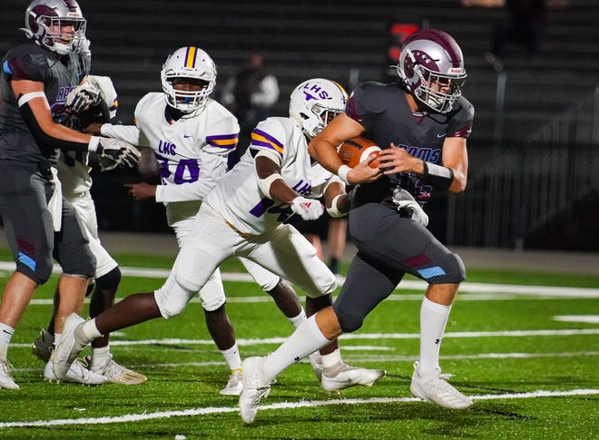 Riverview High quarterback Will Evans runs by Lennard defenders on his way to a touchdown during Friday night's playoff game at the Ram Bowl in Sarasota.
