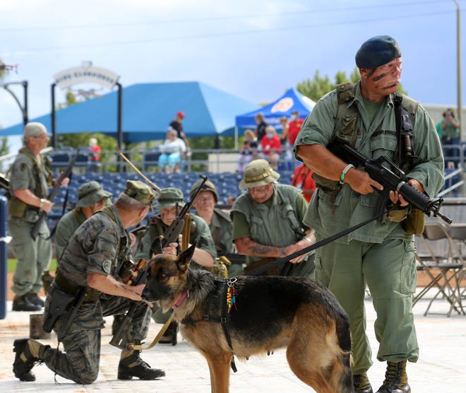 Ted Marshall and Trixie lead a reenactment of the Last Patrol during the Welcome Home Vietnam Vets 2020 celebration Saturday at the Charlotte County Sports Park.