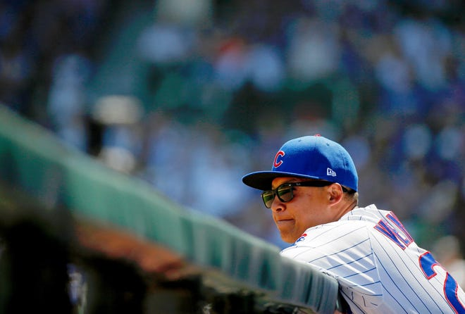 Aug 4, 2019; Chicago, IL, USA; Chicago Cubs first base coach Will Venable (25) leans on the railing of the dugout while watching the game against the Milwaukee Brewers at Wrigley Field. The Chicago Cubs won 7-2.