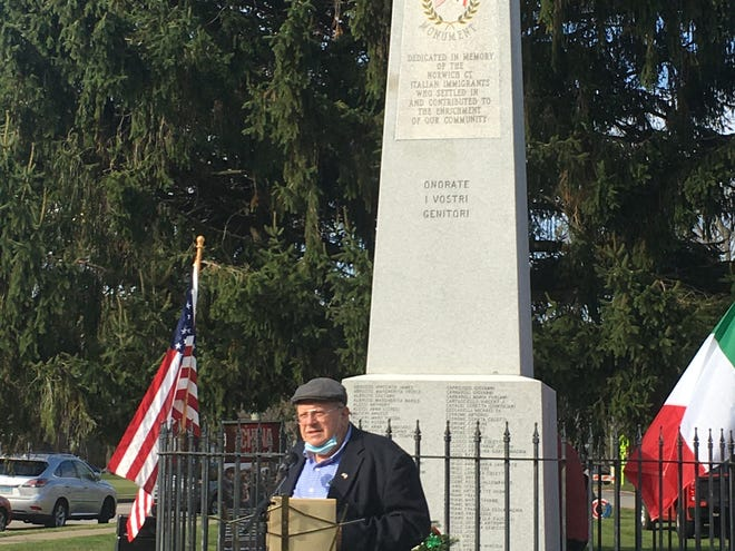 Frank Jacaruso of the Italian Heritage and Cultural Committee stands before the rededicated Italian Heritage monument in Norwich Saturday.
