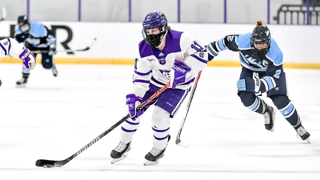 Holy Cross junior Sommer Ross works the puck up ice during Saturday's win over Maine.