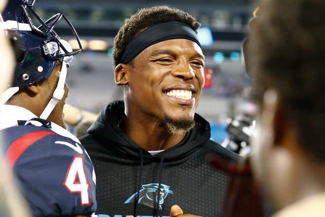 Cam Newton, then with Carolina, talks with Houston quarterback Deshaun Watson after a 2017 game.