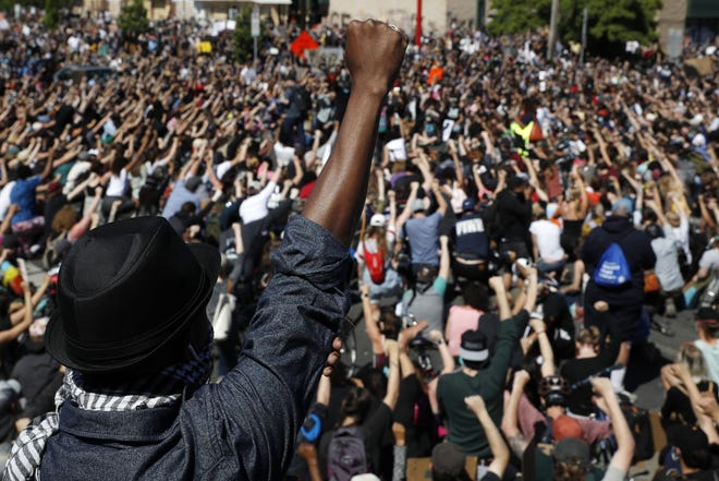 In this May 30 photo, protesters gather in Minneapolis.