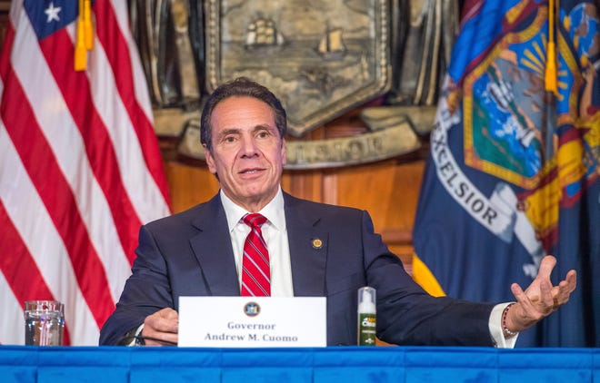 In this Nov. 18 photo provided by the Office of Governor Andrew M. Cuomo, Gov. Cuomo holds a press briefing on the coronavirus in the Red Room at the State Capitol in Albany, N.Y.