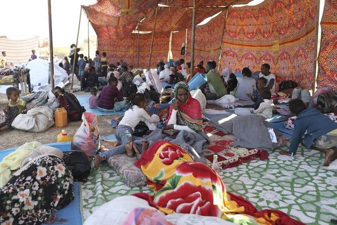 Ethiopian refugees gather Friday in Qadarif region, easter Sudan. Thousands of Ethiopians fled the war in Tigray region into Sudan.