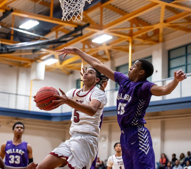 Trinity Christian junior Freddie Dilione  (5) is expected to be one of the top basketball players in Cumberland County this season. He scored 36 points in the Crusaders' opener on Thursday.