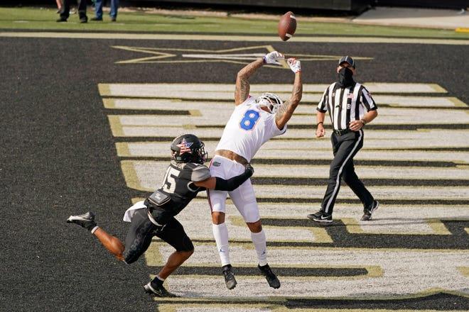 Vanderbilt cornerback Elijah Hamilton (15) breaks up a pass intended for Florida wide receiver Trevon Grimes in the first half Saturday in Nashville, Tenn.
