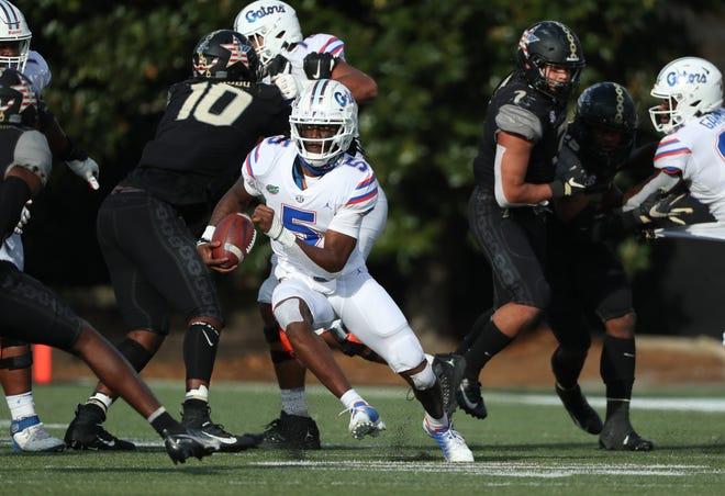 Florida quarterback Emory Jones runs down the field Saturday against Vanderbilt in Nashville, Tenn.