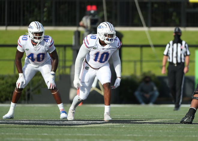 Florida linebackers Jesiah Pierre (40) and Andrew Chatfield Jr. (10) line up before a snap during the Gators' victory 38-17 victory on Nov. 21 at Vanderbilt. Pierre announced Friday he is transferring to Texas Tech. Pierre, a redshirt freshman this season, will retain that class status for 2021 with the NCAA not charging anyone a year's eligibility for 2020