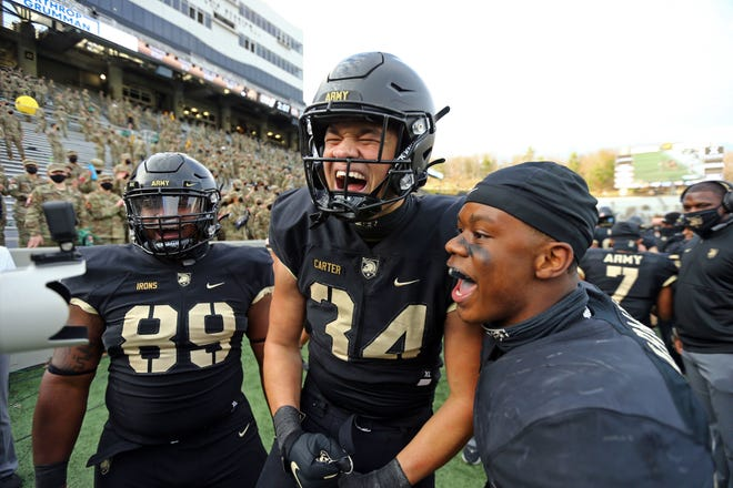Sophomore linebacker Andre Carter (34) celebrates his fourth-quarter interception in Army's 28-27 win over Georgia Southern. Carter also blocked an extra point in his first college start. DANNY WILD/USA TODAY SPORTS