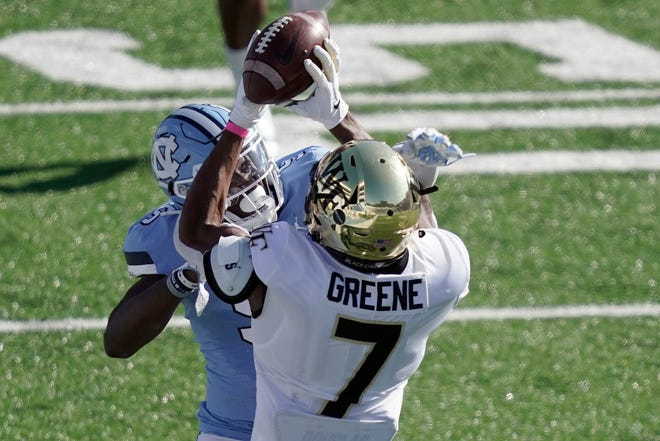 Wake Forest receiver Donavon Greene catches a pass over North Carolina defensive back Patrice Rene in a game last weekend.