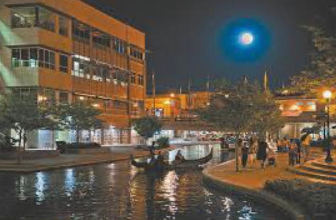 A nighttime view of the Historic Arkansas Riverwalk of Pueblo