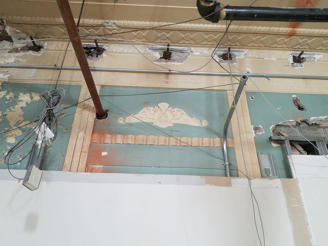 Workers uncovered some of the original 1903s-era decorative features, including plaster reliefs along the ceiling of the original courtroom and council meeting space. The city will incorporate some of the period designs and artwork into the renovated second-floor space.