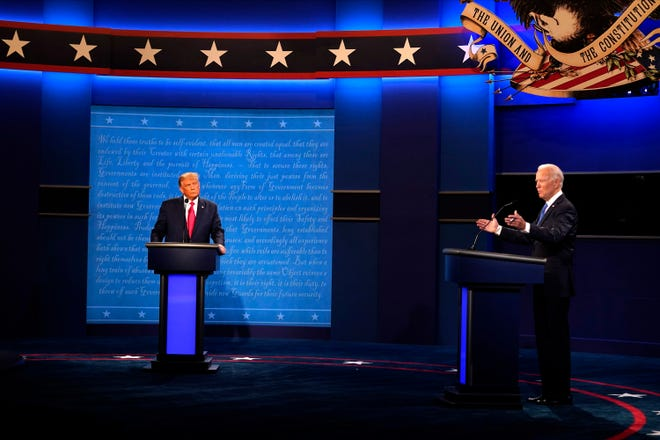Republican candidate President Donald Trump, left, and Democratic presidential candidate former Vice President Joe Biden participate in the second and final presidential debate Thursday, Oct. 22, 2020, at Belmont University in Nashville, Tenn., with (AP Photo/Julio Cortez)