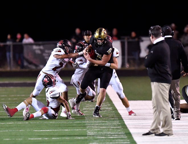 A host of Anson players force Post's Zach Courtney out of bounds during the Antelopes' 61-6 victory Friday night in Clyde. Post improved to 12-0.