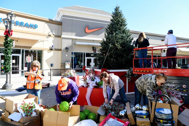 An Ingles Giving Tree is decorated at Asheville Outlets for the holiday season November 20, 2020.