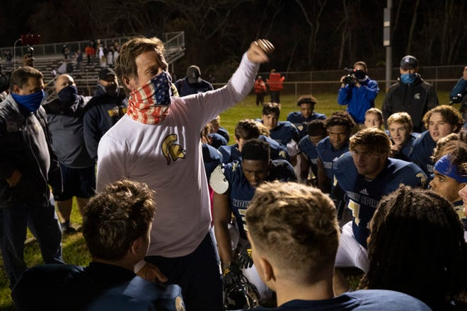 Holy Spirit Head Coach AJ Russo celebrates the win with his team.  Holy Spirit football defeats Lenape 21-7 in Absecon, NJ on November 20, 2020.