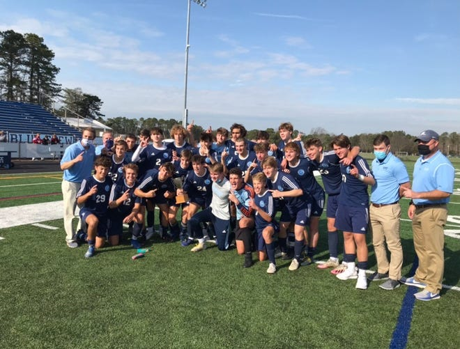 The Shawnee HIgh School boys' soccer team celebrates after capturing the South Jersey Group 4 championship.