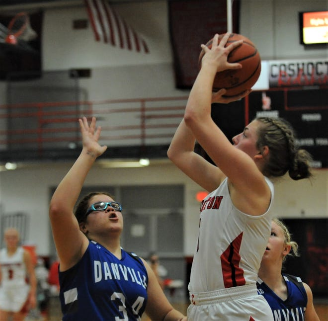 Coshocton's Kindall Shaw puts up a jumper over a Danville defender in Saturday's 88-44 season-opening loss at The Wigwam.