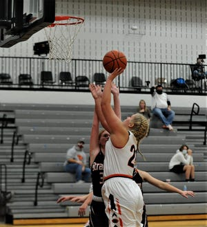 Ridgewood's Kelsie Stephens leans in for a shot against Strasburg's Maddy Edwards in Friday's game. The Generals won 30-27.