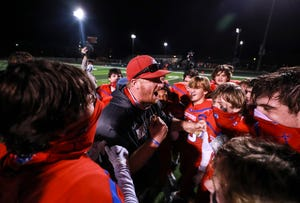 CAL head coach Hunter Cantwell celebrates with his team after the Centurions edged visiting DeSales 7-3 Friday in the first round of playoffs. Nov. 20, 20020