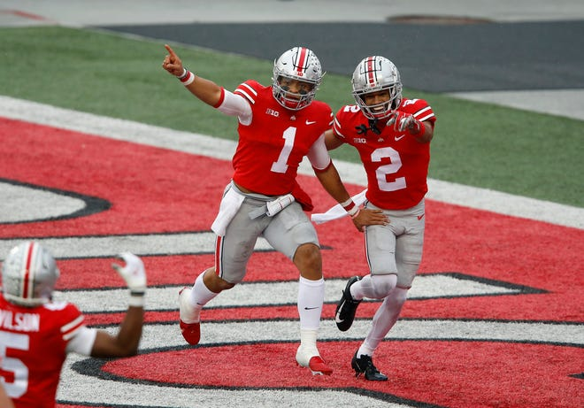 Ohio State quarterback Justin Fields celebrates his second quarter TD run with receiver Chris Olave.