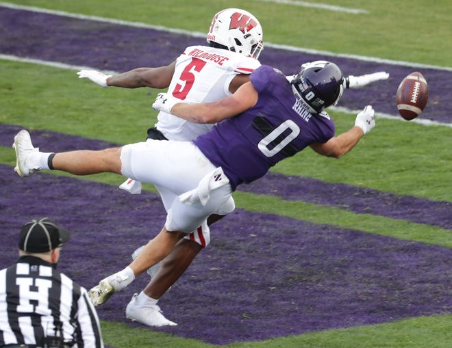 Wisconsin cornerback Rachad Wildgoose is called for pass interference in the end zone while covering Northwestern tight end John Raine in the first quarter Saturday.
