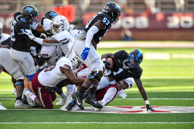 Middle Tennessee's Frank Peasant running the ball against Troy.