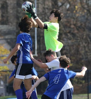 Rutherford goalkeeper Cal Chasxe makes this save in the second half as Rutherford defeated Demarest 3-1 to win the Northeast 2-B regional championship played in Demarest, NJ on November 21, 2020.