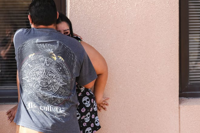 Eric Rodriguez and Marisela Gallegos hug outside Gallegos' mother's room at Memorial Medical Center in Las Cruces on Saturday, Nov. 21, 2020.