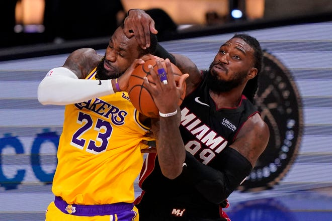 Los Angeles Lakers forward LeBron James and Miami Heat forward Jae Crowder battle for a rebound during the second half in Game 4 of basketball's NBA Finals Tuesday, Oct. 6, 2020, in Lake Buena Vista, Fla. (AP Photo/Mark J. Terrill).