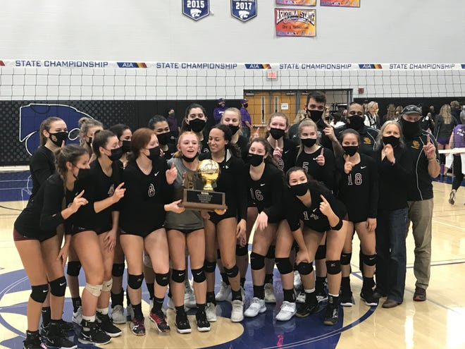 Nov. 21, 2020; Salpointe Catholic celebrates with its AIA 4A state championship trophy after defeating Notre Dame Prep at Gilbert Mesquite High School.