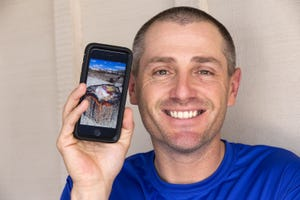 Patrick Fuchs displays his photograph taken two years ago at Petrified Forest National Park, of a colorful piece of petrified wood that unbeknownst to him, went viral on social media.