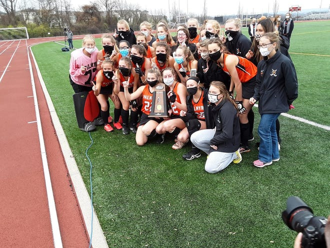 The Palmyra field hockey team celebrates the 2A state championship after Saturday's dramatic 2-1 OT win vs. Archbishop Carroll.