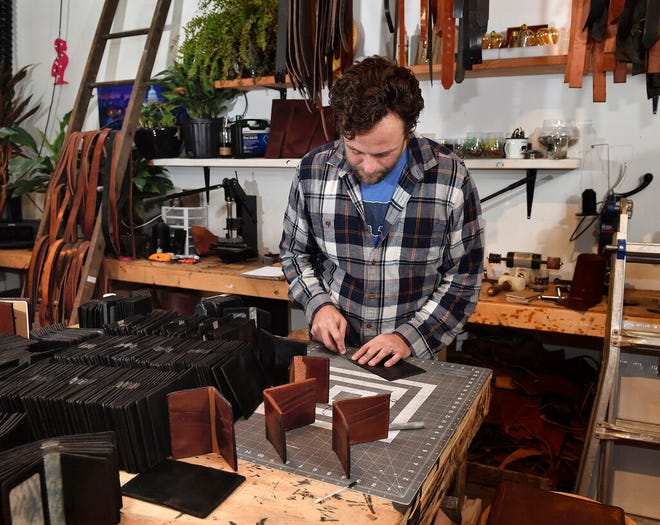 Michael Glick of Black Bear Leather, works in his shop where he has been making wallets for members of the U.S. Congress on Friday, Oct. 30, 2020 in Lancaster, Pa. (Suzette Wenger/LNP/LancasterOnline via AP)