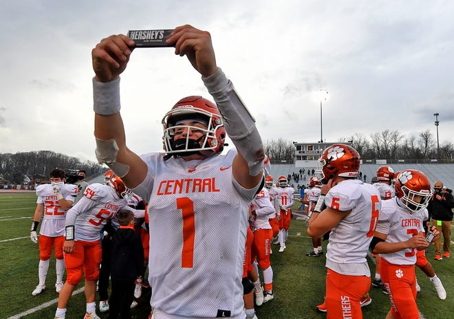 Central York's Beau Pribula holds a Hershey's candy bar up to the crowd after the Panthers defeated McDowell 37-21 in the PIAA Class 6-A state semifinal football game, November 21, 2020. The Panthers will play for the state title next Saturday at Hershey Park Stadium. John A. Pavoncello photo