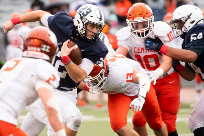 McDowell's Chris Juchno runs through Central York's defense in the PIAA Class 6A semifinal at Mansion Park Stadium on Saturday in Altoona, Pa. Juchno threw for 196 yards, but the Trojans lost 37-21.