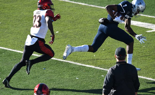 Nevada's Romeo Doubs hauls in a long pass against San Diego State on Saturday.