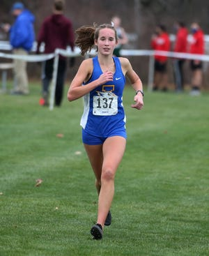 Irondequoit's Candace Tytler races down the home stretch on her way to winning the girls Section V Class A Cross Country Championships held Saturday, Nov. 21, 2020, at Parma Park in Hilton. Tytler finished the race in 18:33.7.