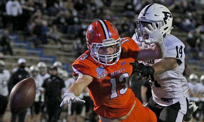 Seth Levesque, center, tries to make a leaping catch for Central during a game against Permian on Friday, Nov. 20, 2020.