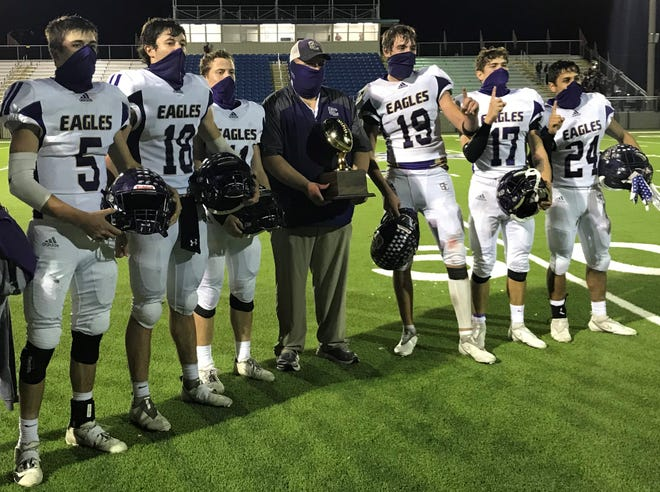 Sterling City High School football seniors (from left to right) Jarett Justiss (5), Hudson Cox (18), Cross Knittel (11), Chance Ferguson (19), Kamden Pruitt (17) and Francisco Gonzales (24) pose for a photo with Eagles' offensive coordinator Tye Keith after their 100-88 win over Rankin in the Class 1A Division II playoffs Friday, Nov. 20, 2020, at Bird Memorial Stadium in Big Lake.