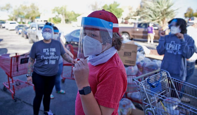 C.L. Fogle, center, volunteers at a food distribution event at the St. Paul Presbyterian Church in San Angelo on Saturday, Nov. 21, 2020.