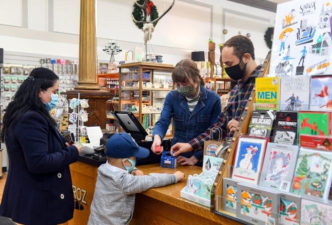 Customers shop on Saturday, November 21, at Zandbroz Variety in Sioux Falls.