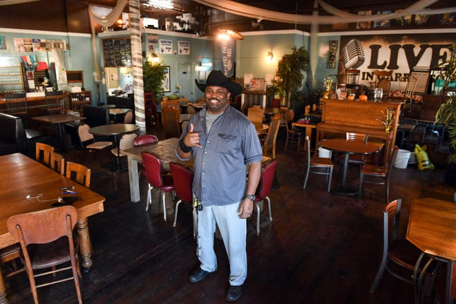 Omar Thornton poses in the dining room of his restaurant on Friday, November 20, at O So Good in Garretson.