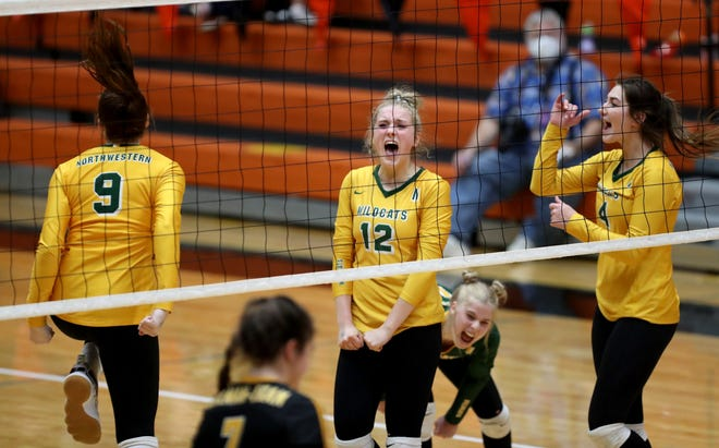 Northwestern's Haiden Grandpre (9), Sydney Schell (12), Joclyn Haven, back center and Hannah Schentzel (4) celebrate as the Wildcats defeated Colman-Egan in straight sets Friday night to advance to the championship game at the South Dakota Class B Volleyball tournament in Huron.