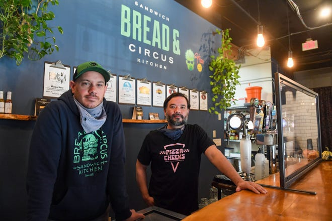 Barry Putzke and Jordan Taylor stand in the kitchen on Wednesday, November 18, at Bread and Circus Sandwich Kitchen in Sioux Falls.