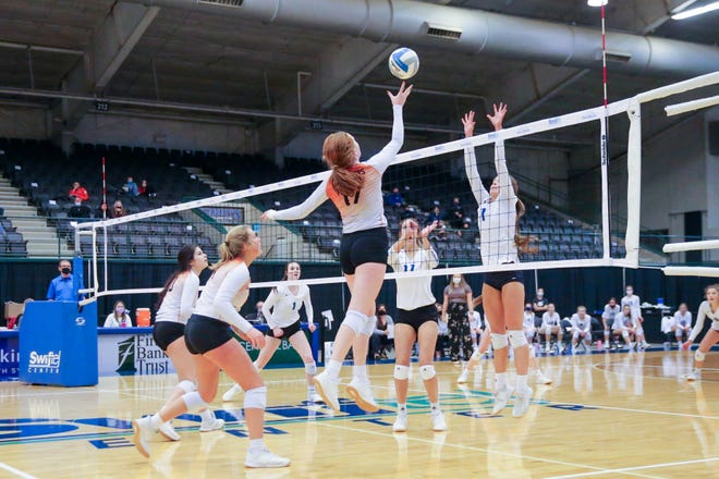 Washington #17 Joslyn Richardson hits the ball over the net Friday night against O'Gorman in Brookings, SD at the AA State Volleyball Tournament2.  O'Gorman won in 3 sets.