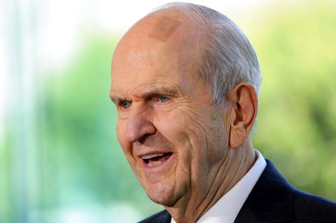 FILE - In this April 19, 2019, file photo, the Church of Jesus Christ of Latter-day Saints President Russell M. Nelson speaks during a news conference at the Temple Square South Visitors Center in Salt Lake City. Nelson called on members Friday, Nov. 20, 2020, to flood social media over Thanksgiving week with messages of gratitude in what he hopes will serve as a healing tool as the world grapples with the coronavirus pandemic, racism and a lack of civility. (AP Photo/Rick Bowmer, File)