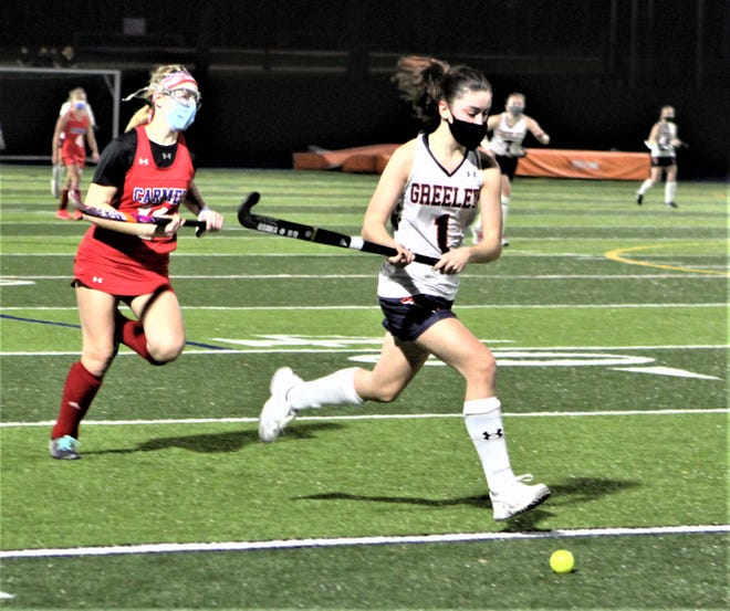 Carmel's Katie Brown (l) chases Horace Greeley's Cat Salamida during the Quakers' 2-0 playoff win over Carmel Nov. 20, 2020.