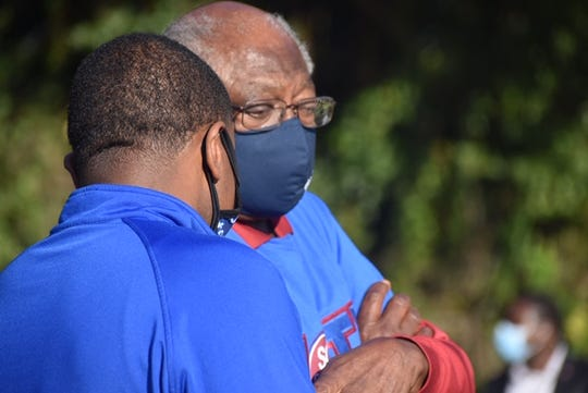 South Carolina Rep. James Clyburn huddled to discuss strategies with his political advisor Antjuan Seawright at a campaign rally Nov. 1, 20202 in North Charleston.